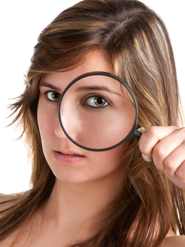 Woman looking trough a loupe